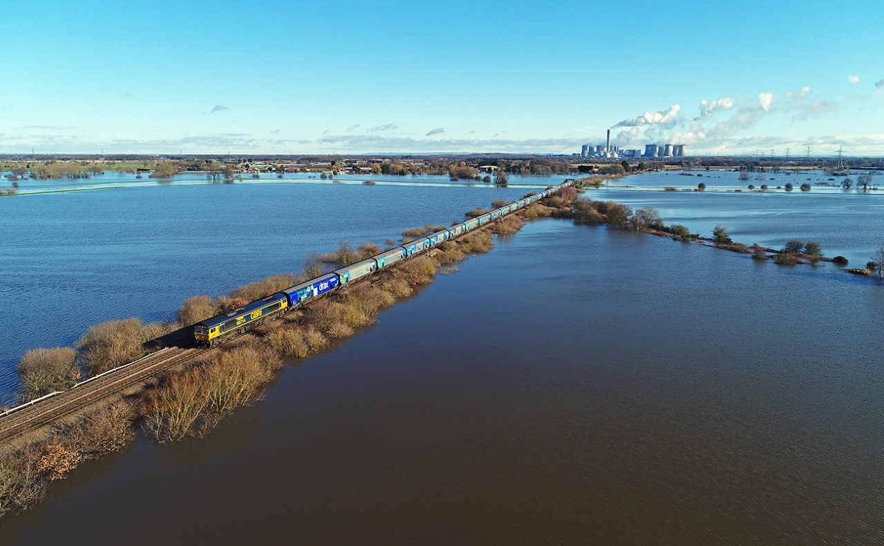 A GBRf biomass train makes its way from Drax Power Station after the February floods. Credit: Chris Davis.