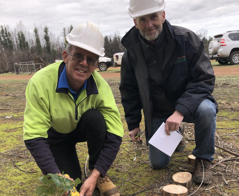 Image: Rob Heathcote and Keith Lamb take samples for moisture in fire-damaged timber